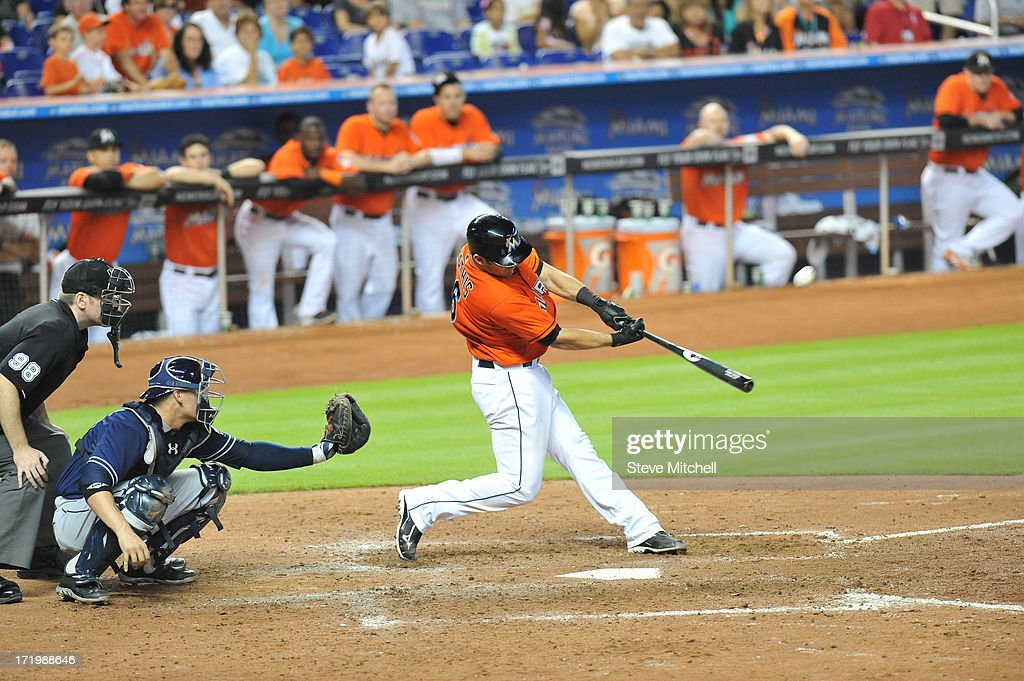 <a gi-track='captionPersonalityLinkClicked' href=/galleries/search?phrase=Jeff+Mathis&family=editorial&specificpeople=660661 ng-click='$event.stopPropagation()'>Jeff Mathis</a> #6 of the Miami Marlins hits a grand slam during the ninth inning against the San Diego Padres at Marlins Park on June 30, 2013 in Miami, Florida. Marlins won 6-2