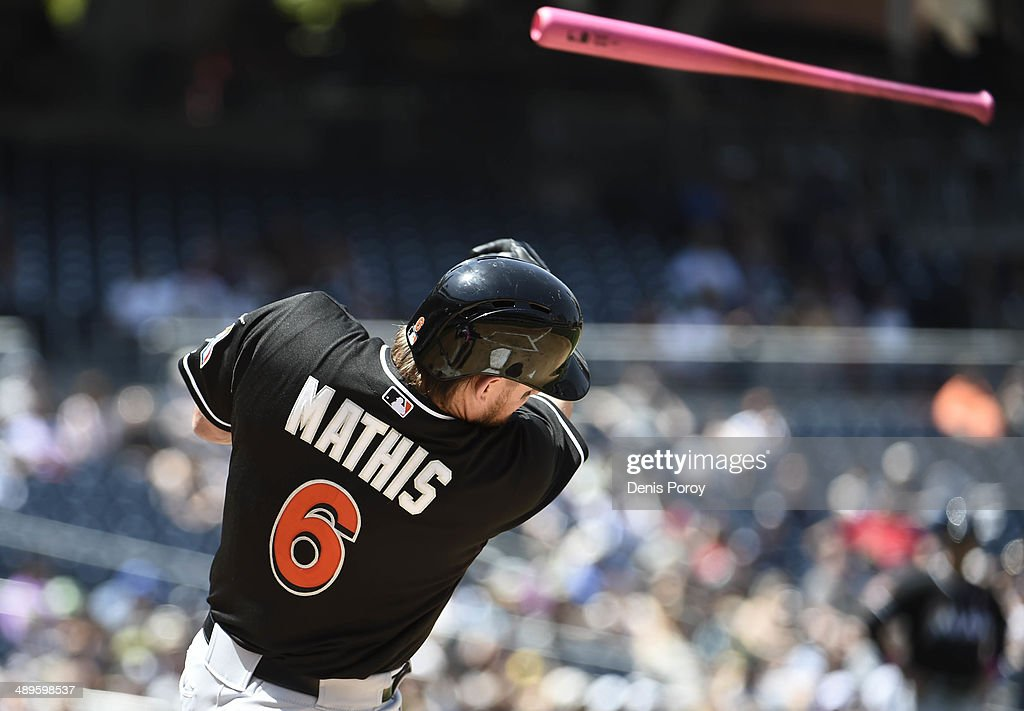 <a gi-track='captionPersonalityLinkClicked' href=/galleries/search?phrase=Jeff+Mathis&family=editorial&specificpeople=660661 ng-click='$event.stopPropagation()'>Jeff Mathis</a> #6 of the Miami Marlins loses hit bat into the stands during the second inning of a baseball game against the San Diego Padres at Petco Park May 11, 2014 in San Diego, California.