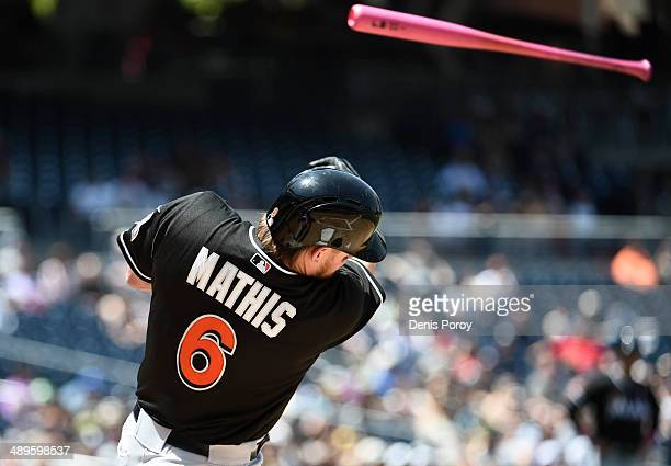 Jeff Mathis of the Miami Marlins loses hit bat into the stands during the second inning of a baseball game against the San Diego Padres at Petco Park...