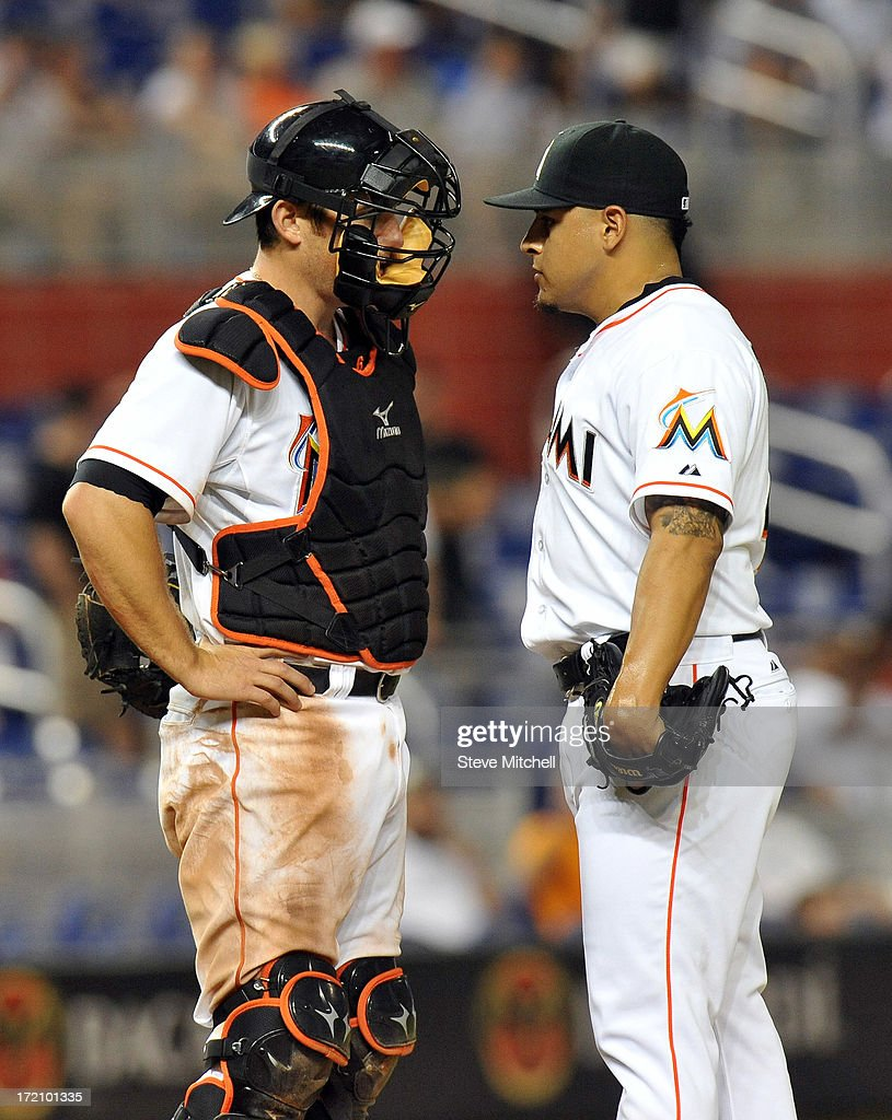 <a gi-track='captionPersonalityLinkClicked' href=/galleries/search?phrase=Jeff+Mathis&family=editorial&specificpeople=660661 ng-click='$event.stopPropagation()'>Jeff Mathis</a> #6 of the Miami Marlins talks with A.J. Ramos #44 of the Miami Marlins during the ninth inning against the San Diego Padres at Marlins Park on July 1, 2013 in Miami, Florida.