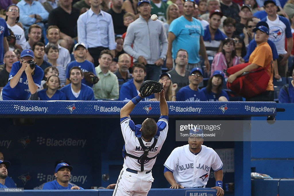 <a gi-track='captionPersonalityLinkClicked' href=/galleries/search?phrase=Jeff+Mathis&family=editorial&specificpeople=660661 ng-click='$event.stopPropagation()'>Jeff Mathis</a> #6 of the Toronto Blue Jays catches a foul pop-up in the second inning during MLB game action against the Tampa Bay Rays on August 30, 2012 at Rogers Centre in Toronto, Ontario, Canada.