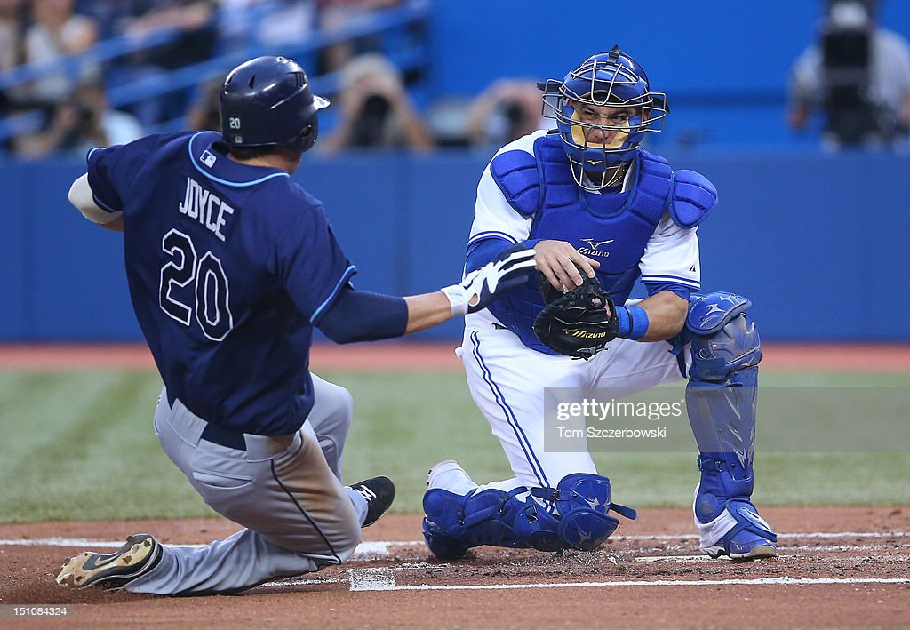 <a gi-track='captionPersonalityLinkClicked' href=/galleries/search?phrase=Jeff+Mathis&family=editorial&specificpeople=660661 ng-click='$event.stopPropagation()'>Jeff Mathis</a> #6 of the Toronto Blue Jays tags out Matt Joyce #20 of the Tampa Bay Rays at home plate in the second inning during MLB game action on August 31, 2012 at Rogers Centre in Toronto, Ontario, Canada.