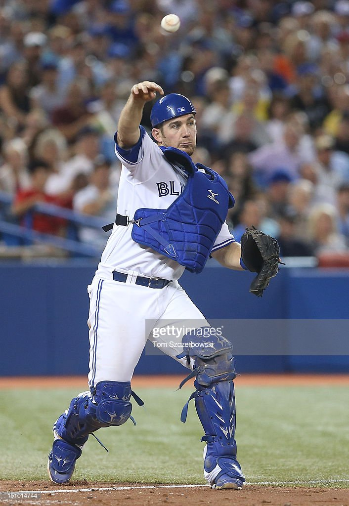 <a gi-track='captionPersonalityLinkClicked' href=/galleries/search?phrase=Jeff+Mathis&family=editorial&specificpeople=660661 ng-click='$event.stopPropagation()'>Jeff Mathis</a> #6 of the Toronto Blue Jays throws out a baserunner after a strikeout in the eighth inning during MLB game action against the Tampa Bay Rays on August 30, 2012 at Rogers Centre in Toronto, Ontario, Canada.