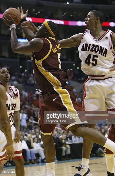 Jeff McMillan of the USC Trojans goes to the basket past Channing Fyre of the Arizona Wildcats during the quarterfinals of the 2004 Pacific Life...