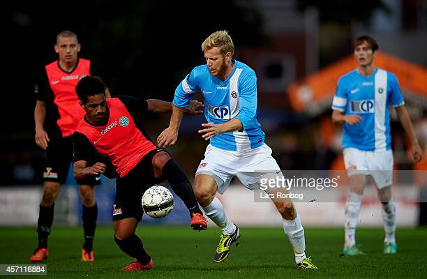Jeff Mensah of Viborg FF and Lars Brogger Hansen of FC Roskilde compete for the ball during the Danish NordicBet Liga match between FC Roskilde and...