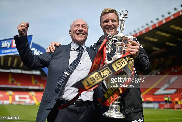 Jeff Mostyn chairman of Bournemouth and Eddie Howe Manager of AFC Bournemouth lift the Championship trophy after winning the the Sky Bet Championship...