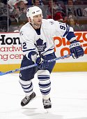 Jeff O'Neill of the Toronto Maple Leafs skates for the puck during the game against the Ottawa Senators on October 5 2006 at the Scotiabank Place in...