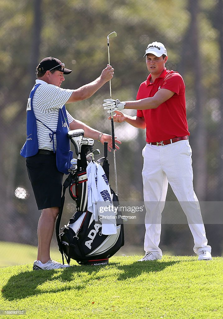 Jeff Overton takes a club from his bag during the final round of the Sony Open in Hawaii at Waialae Country Club on January 13, 2013 in Honolulu, Hawaii.