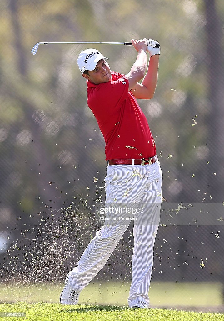 Jeff Overton takes his second shot on the ninth hole during the final round of the Sony Open in Hawaii at Waialae Country Club on January 13, 2013 in Honolulu, Hawaii.