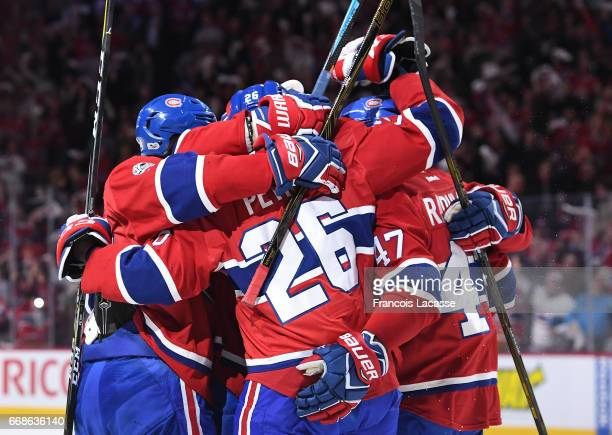 Jeff Petry and Alexander Radulov of the Montreal Canadiens celebrate after scoring a goal against the New York Rangers in Game Two of the Eastern...