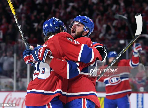 Jeff Petry and Alexander Radulov of the Montreal Canadiens celebrate a goal against the New York Rangers in Game Two of the Eastern Conference...
