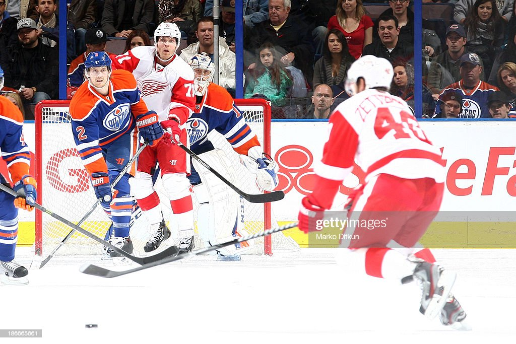 <a gi-track='captionPersonalityLinkClicked' href=/galleries/search?phrase=Jeff+Petry&family=editorial&specificpeople=570439 ng-click='$event.stopPropagation()'>Jeff Petry</a> #2 and <a gi-track='captionPersonalityLinkClicked' href=/galleries/search?phrase=Jason+LaBarbera&family=editorial&specificpeople=240674 ng-click='$event.stopPropagation()'>Jason LaBarbera</a> #1 of the Edmonton Oilers battle for position against <a gi-track='captionPersonalityLinkClicked' href=/galleries/search?phrase=Daniel+Cleary&family=editorial&specificpeople=220490 ng-click='$event.stopPropagation()'>Daniel Cleary</a> #71 of the Detroit Red Wings on November 2, 2013 at Rexall Place in Edmonton, Alberta, Canada.