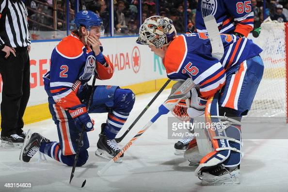 Jeff Petry and Viktor Fasth of the Edmonton Oilers exchange words in a game against the Anaheim Ducks on April 6 2014 at Rexall Place in Edmonton...