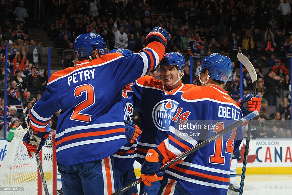 <a gi-track='captionPersonalityLinkClicked' href=/galleries/search?phrase=Jeff+Petry&family=editorial&specificpeople=570439 ng-click='$event.stopPropagation()'>Jeff Petry</a> #2, <a gi-track='captionPersonalityLinkClicked' href=/galleries/search?phrase=Nail+Yakupov&family=editorial&specificpeople=7419136 ng-click='$event.stopPropagation()'>Nail Yakupov</a> #64, and <a gi-track='captionPersonalityLinkClicked' href=/galleries/search?phrase=Jordan+Eberle&family=editorial&specificpeople=4898161 ng-click='$event.stopPropagation()'>Jordan Eberle</a> #14 of the Edmonton Oilers celebrate after scoring a goal in a game against the Winnipeg Jets on December 23, 2013 at Rexall Place in Edmonton, Alberta, Canada.