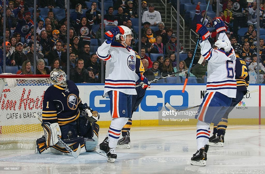 <a gi-track='captionPersonalityLinkClicked' href=/galleries/search?phrase=Jeff+Petry&family=editorial&specificpeople=570439 ng-click='$event.stopPropagation()'>Jeff Petry</a> #2 of the Edmonton Oilers celebrates his first-period goal against <a gi-track='captionPersonalityLinkClicked' href=/galleries/search?phrase=Jhonas+Enroth&family=editorial&specificpeople=570456 ng-click='$event.stopPropagation()'>Jhonas Enroth</a> #1 of the Buffalo Sabres with teammate <a gi-track='captionPersonalityLinkClicked' href=/galleries/search?phrase=Nail+Yakupov&family=editorial&specificpeople=7419136 ng-click='$event.stopPropagation()'>Nail Yakupov</a> #64 on February 3, 2014 at the First Niagara Center in Buffalo, New York.