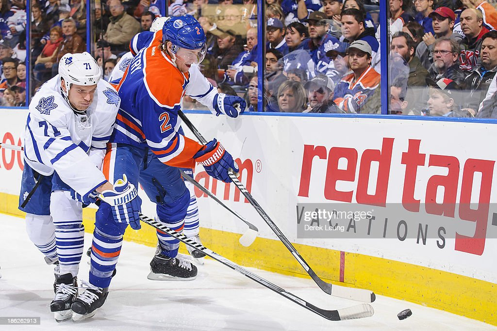 <a gi-track='captionPersonalityLinkClicked' href=/galleries/search?phrase=Jeff+Petry&family=editorial&specificpeople=570439 ng-click='$event.stopPropagation()'>Jeff Petry</a> #2 of the Edmonton Oilers fights for the puck against David Clarkson #71 of the Toronto Maple Leafs during an NHL game on October, 29, 2013 at Rexall Place in Edmonton, AB, Canada.