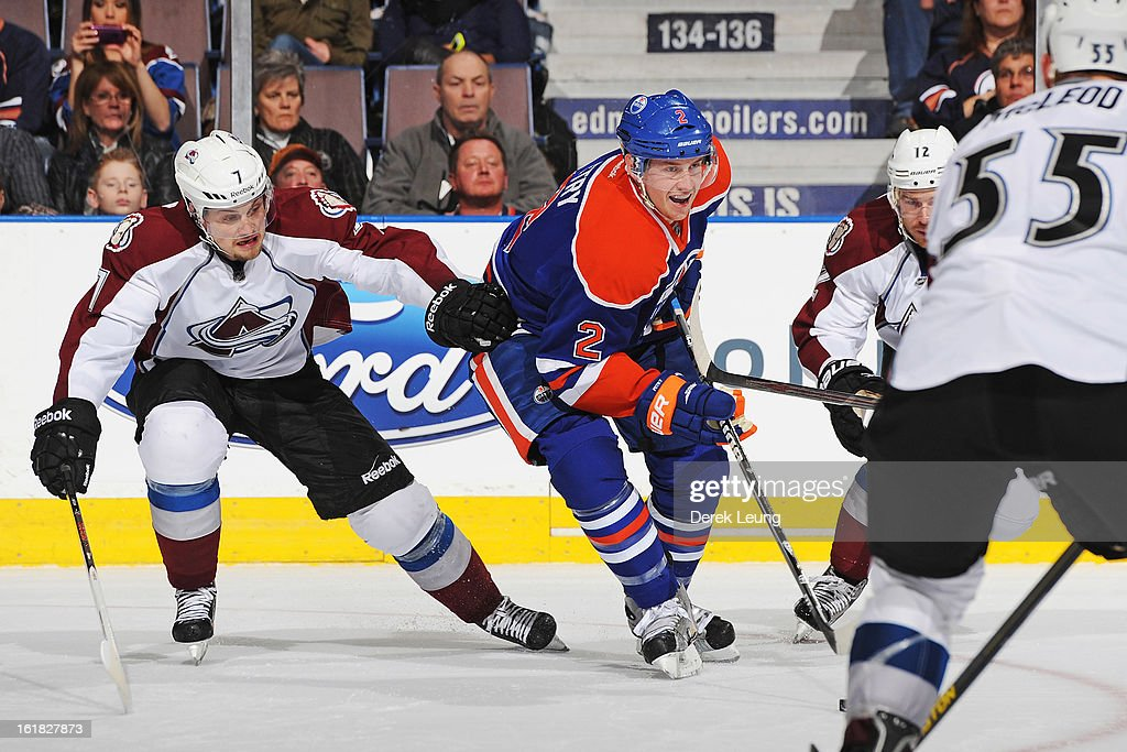 Jeff Petry #2 of the Edmonton Oilers skates past the defense of John Mitchell #7, <a gi-track='captionPersonalityLinkClicked' href=/galleries/search?phrase=Chuck+Kobasew&family=editorial&specificpeople=208995 ng-click='$event.stopPropagation()'>Chuck Kobasew</a> #12, and <a gi-track='captionPersonalityLinkClicked' href=/galleries/search?phrase=Cody+McLeod&family=editorial&specificpeople=2242985 ng-click='$event.stopPropagation()'>Cody McLeod</a> #55 of the Colorado Avalanche during the NHL game at Rexall Place on February 16, 2013 in Edmonton, Alberta, Canada. Oilers won 6-4.