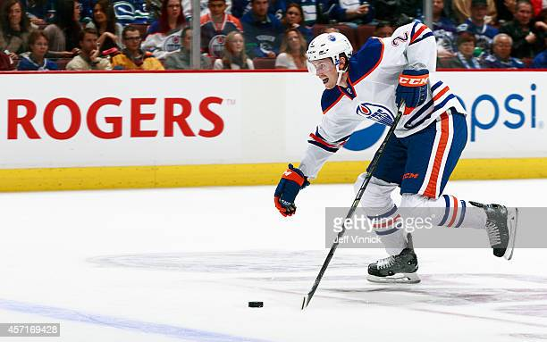 Jeff Petry of the Edmonton Oilers skates up ice with the puck during their NHL game against the Vancouver Canucks at Rogers Arena October 11 2014 in...