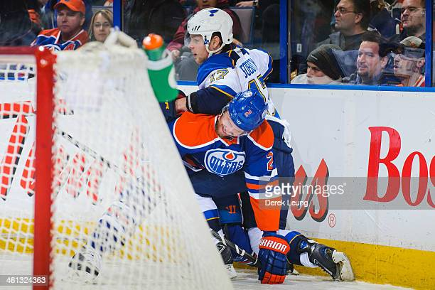 Jeff Petry of the Edmonton Oilers ties up Vladimir Sobotka of the St Louis Blues during an NHL game at Rexall Place on January 7 2014 in Edmonton...