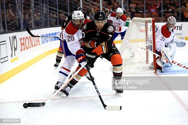 Jeff Petry of the Montreal Canadiens battles Andrew Cogliano of the Anaheim Ducks for a loose puck during the first period of a game at Honda Center...