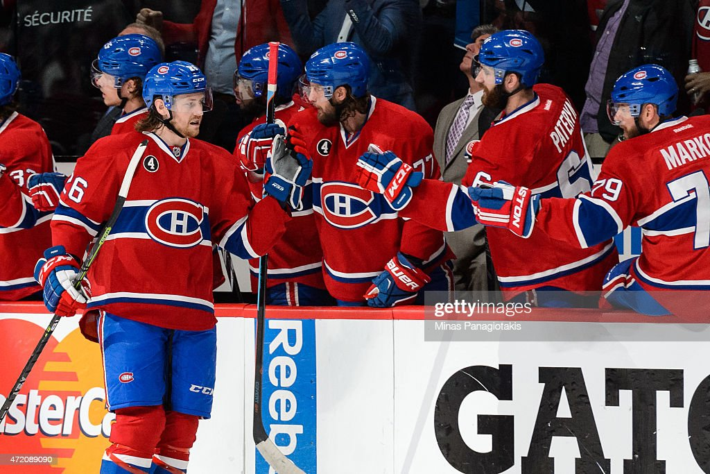 Jeff Petry of the Montreal Canadiens celebrates his goal with teammates on the bench in Game Two of the Eastern Conference Semifinals against the...