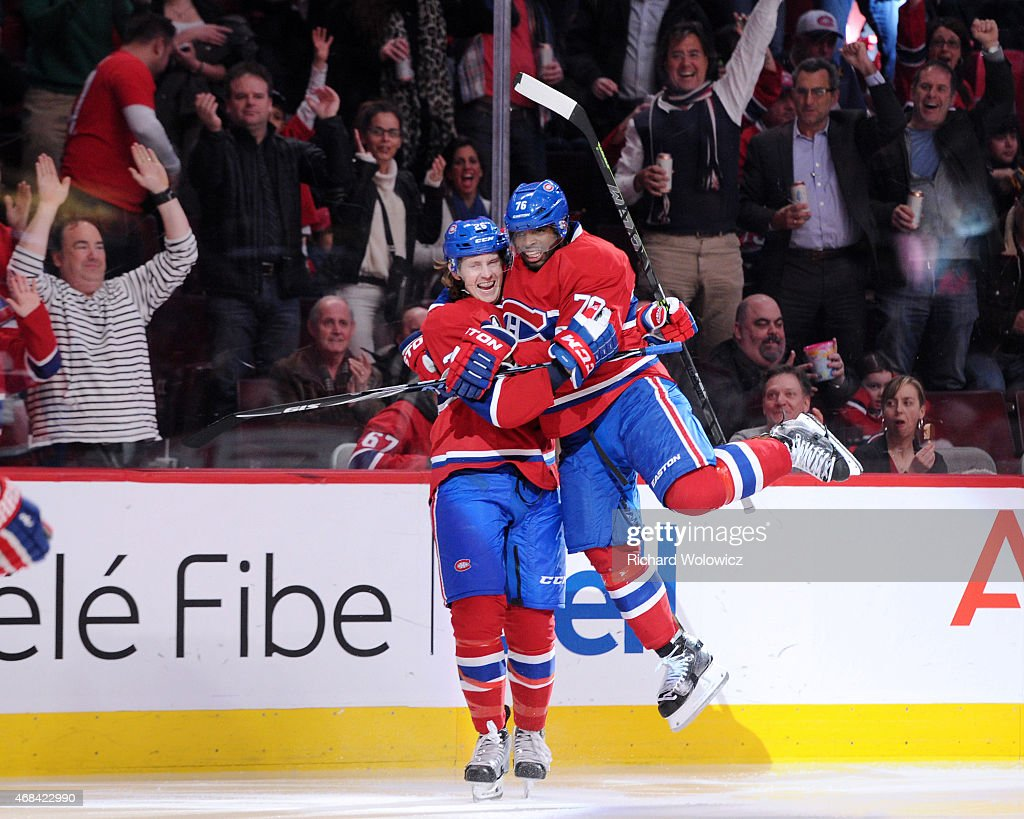 Jeff Petry of the Montreal Canadiens celebrates his second period goal with teammate PK Subban during the NHL game against the Washington Capitals at...