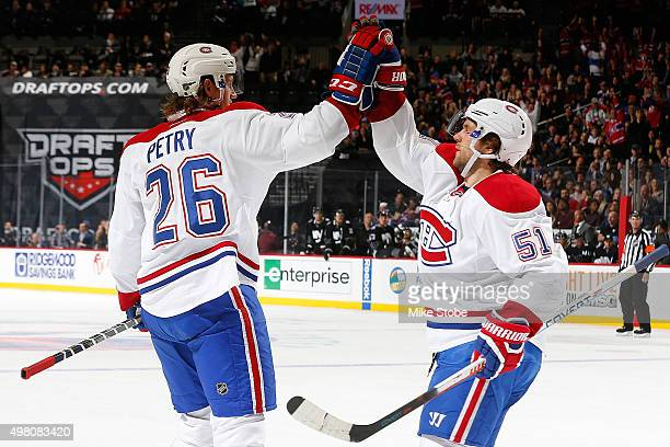 Jeff Petry of the Montreal Canadiens celebrates his second period goal with teammate David Desharnais against the New York Islanders at the Barclays...