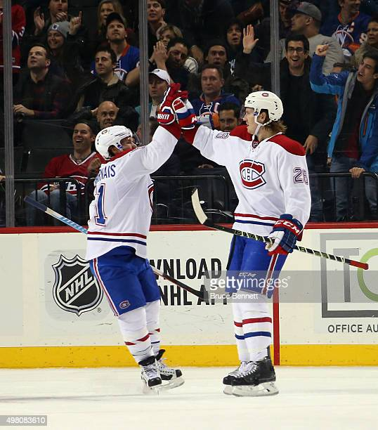 Jeff Petry of the Montreal Canadiens celebrates his second period goal against the New York Islanders along with Brendan Gallagher at the Barclays...