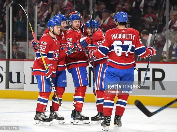 Jeff Petry of the Montreal Canadiens celebrates with teammates his first period goal against the Toronto Maple Leafs in the NHL game at the Bell...