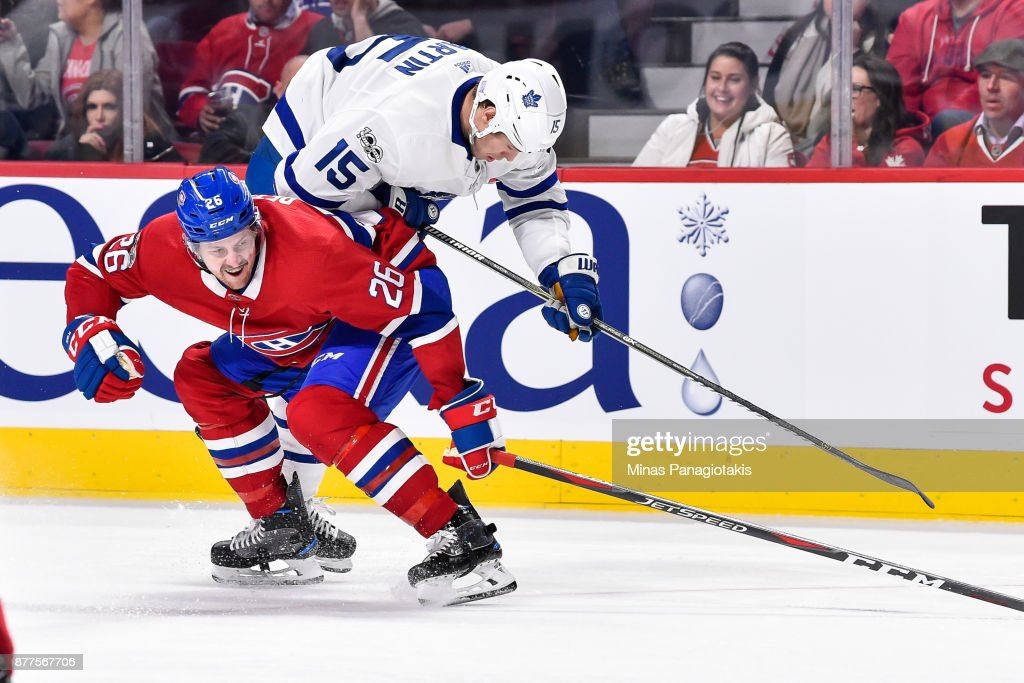 Jeff Petry #26 of the Montreal Canadiens challenges Matt Martin #15 of the Toronto Maple Leafs during the NHL game at the Bell Centre on November 18, 2017 in Montreal, Quebec, Canada. The Toronto Maple Leafs defeated the Montreal Canadiens 6-0.