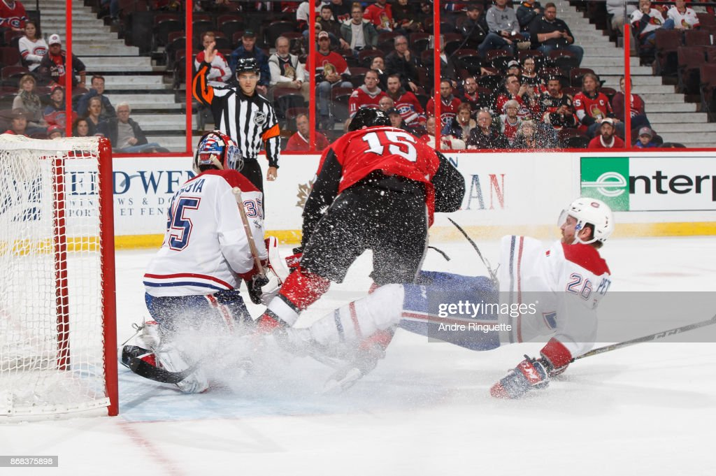 Jeff Petry #26 of the Montreal Canadiens hauls down Zack Smith #15 of the Ottawa Senators for a penalty as he collides with Al Montoya #35 in the crease at Canadian Tire Centre on October 30, 2017 in Ottawa, Ontario, Canada.