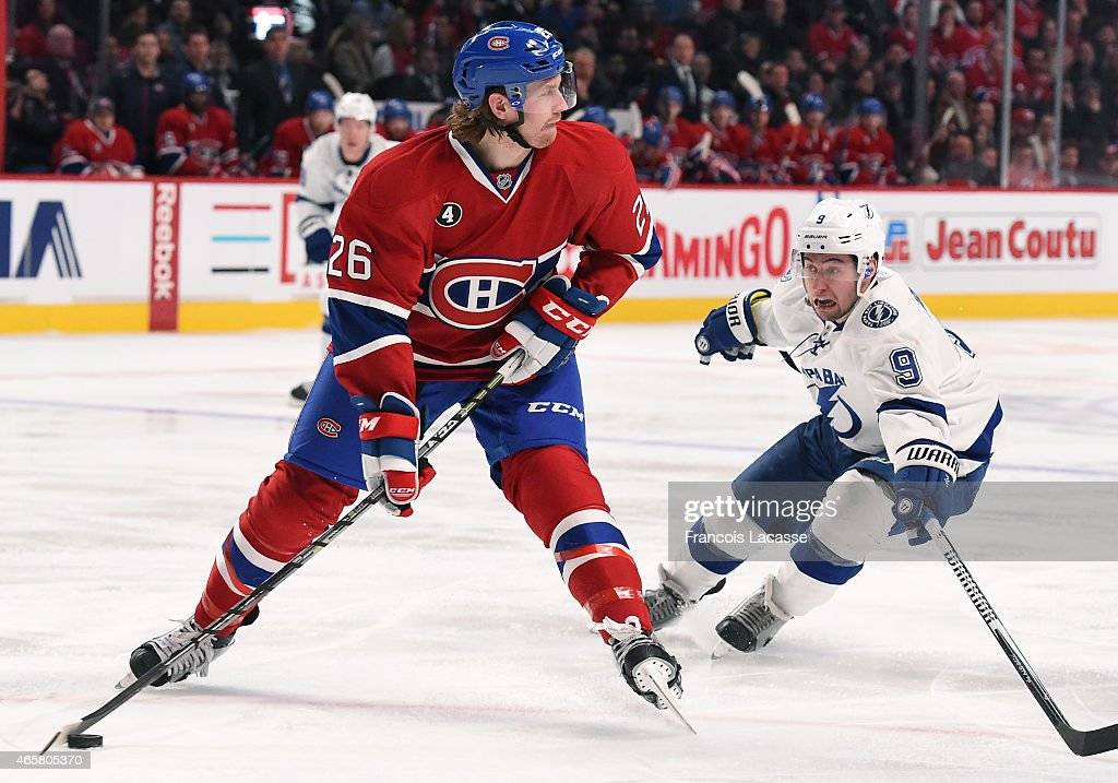 Jeff Petry of the Montreal Canadiens looks to pass the puck against Tyler Johnson of the Tampa Bay Lightning in the NHL game at the Bell Centre on...