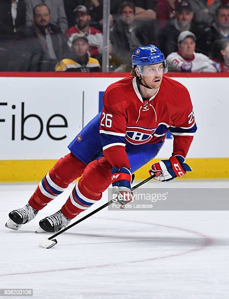 Jeff Petry of the Montreal Canadiens looks to pass the puck against the Boston Bruins in the NHL game at the Bell Centre on December 12 2016 in...