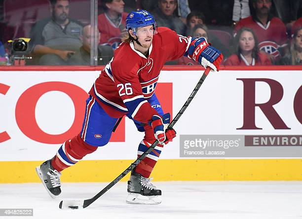 Jeff Petry of the Montreal Canadiens passes the puck against the StLouis Blues in the NHL game at the Bell Centre on October 20 2015 in Montreal...