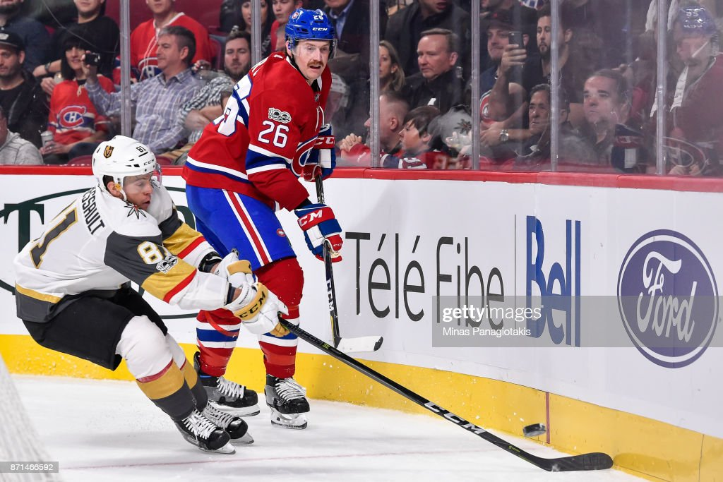 Jeff Petry #26 of the Montreal Canadiens plays the puck along the boards against Jonathan Marchessault #81 of the Vegas Golden Knights during the NHL game at the Bell Centre on November 7, 2017 in Montreal, Quebec, Canada. The Montreal Canadiens defeated the Vegas Golden Knights 3-2.