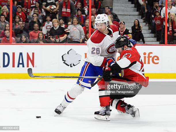 Jeff Petry of the Montreal Canadiens takes down Curtis Lazar of the Ottawa Senators during the NHL game at Canadian Tire Centre on October 11 2015 in...