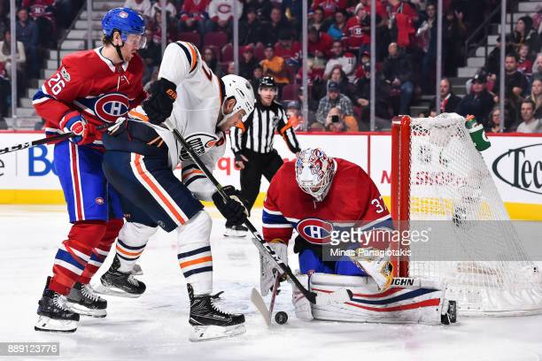 Jeff Petry of the Montreal Canadiens tries to defend against Milan Lucic of the Edmonton Oilers while goaltender Antti Niemi makes a save during the...