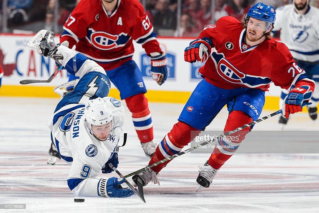 Jeff Petry of the Montreal Canadiens trips Tyler Johnson of the Tampa Bay Lightning in Game Five of the Eastern Conference Semifinals during the 2015...