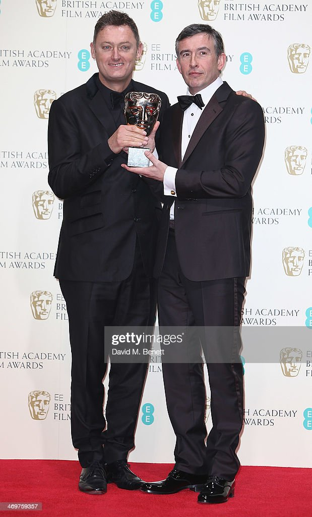 Jeff Pope and Steve Coogan winners of the Best Adapted Screenplay award poses in the winners room at the EE British Academy Film Awards 2014 at The...