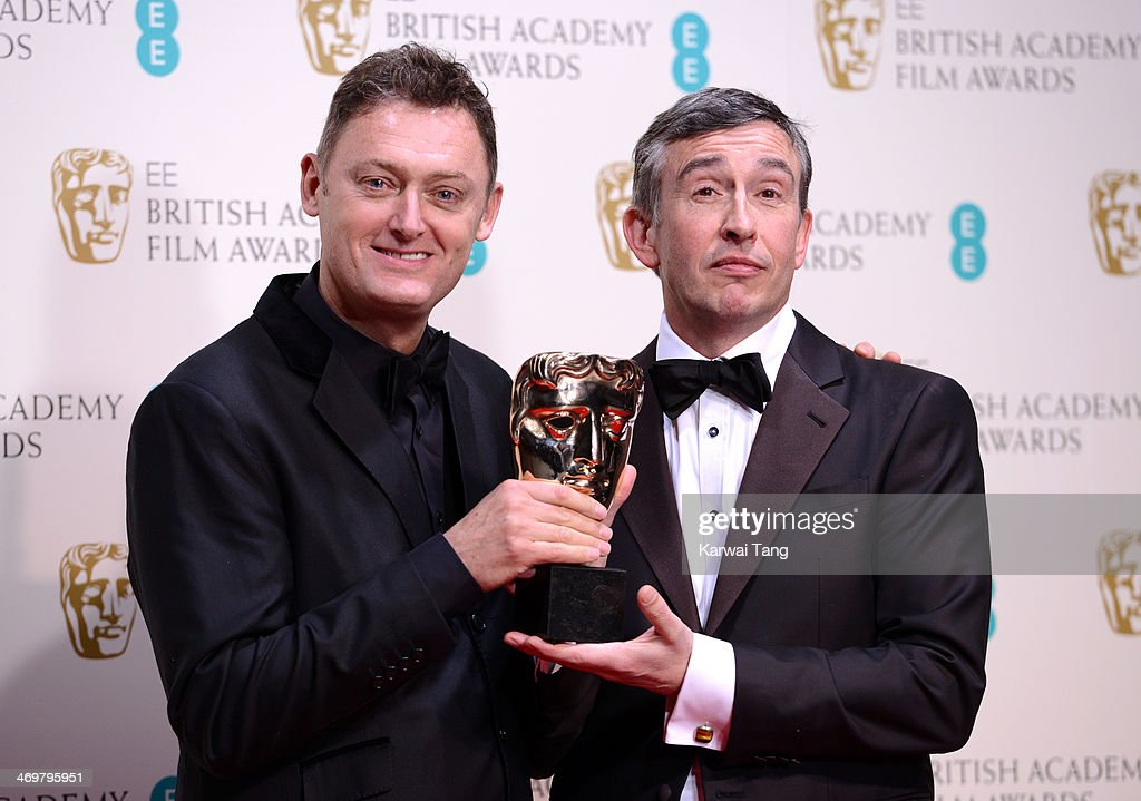 Jeff Pope and Steve Coogan winners of the Best Adapted Screenplay award pose in the winners room at the EE British Academy Film Awards 2014 at The...