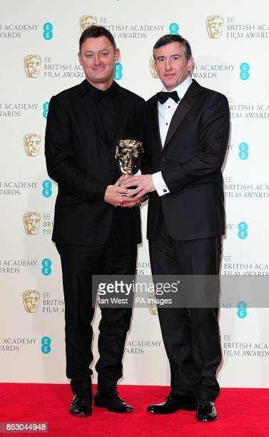 Jeff Pope and Steve Coogan with the award for adapted screenplay for 'Philomena' at The EE British Academy Film Awards 2014 at the Royal Opera House...
