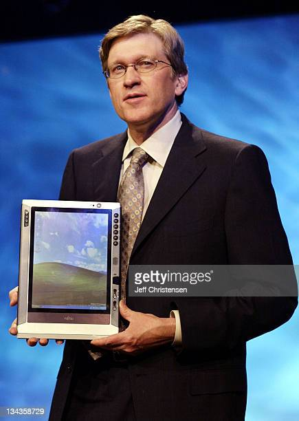 Jeff Raikes group vice president at Microsoft shows a new Fujitsu tablet PC to employees June 24 2002 in New York City as he prepared for a keynote...