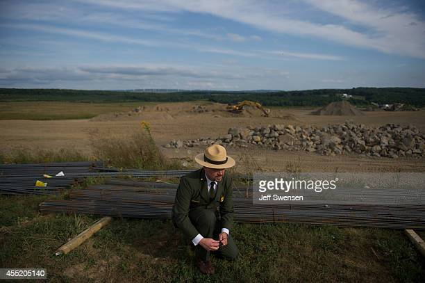 Jeff Reinbold superintendent of the National Park Service in Western Pennsylvania ties his shoe during a media tour of the construction site at the...