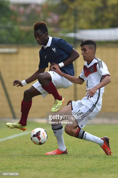 Jeff Reine Adelaide of France is challenged by Aymane Barkok of Germany during the International Friendly match between U16 France and U16 Germany at...