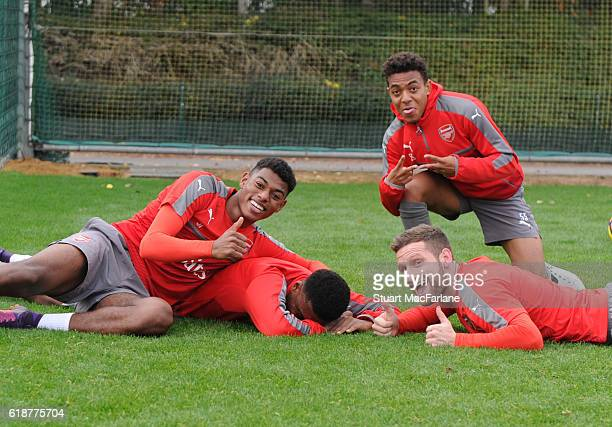 Jeff ReineAdelaide Alex Iwobi Donyell Malen and Shkodran Mustafi of Arsenal during a training session at London Colney on October 28 2016 in St...