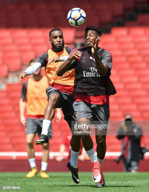 Jeff ReineAdelaide and Alexandre Lacazette of Arsenal during the Arsenal Training Session at Emirates Stadium on August 3 2017 in London England