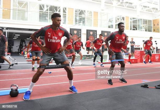 Jeff ReineAdelaide and Danny Welbeck of Arsenal during a training session at London Colney on July 4 2017 in St Albans England