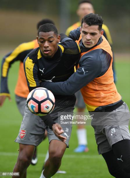 Jeff ReineAdelaide and Granit Xhaka of Arsenal during a training session at London Colney on March 10 2017 in St Albans England