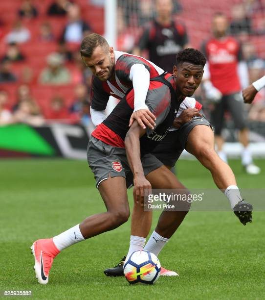 Jeff ReineAdelaide and Jack Wilshere of Arsenal during the Arsenal Training Session at Emirates Stadium on August 3 2017 in London England