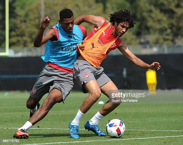 Jeff ReineAdelaide and Mohamed Elneny of Arsenal during a training session at San Jose State University on July 27 2016 in San Jose California